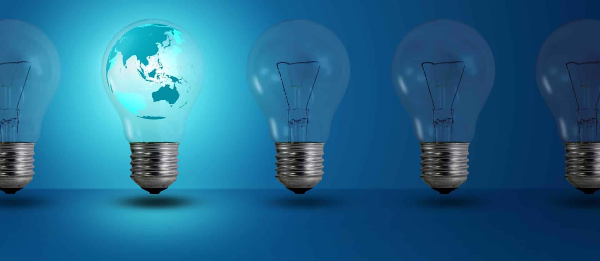 map inside glow among other light bulb on a blue background